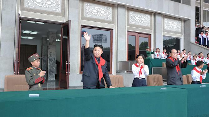 In this June 6, 2012 photo released by the Korean Central News Agency and distributed by the Korea News Service, North Korea's young leader Kim Jong Un, second left, waves as he attends a celebration to mark the 66th anniversary of the founding of the Korean Children's Union in Pyongyang, North Korea. Kim made his second speech on Wednesday at a major public event since taking power in December, addressing a children's rally aimed at winning a new generation's support. (AP Photo/Korean Central News Agency via Korea News Service) JAPAN OUT UNTIL 14 DAYS AFTER THE DAY OF TRANSMISSION