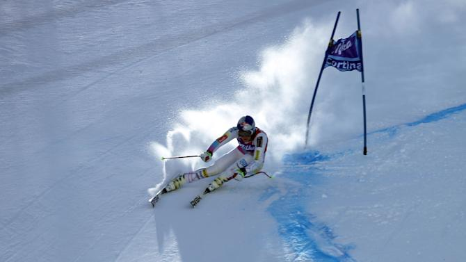 Lindsey Vonn, of the United States, speeds down the course on her way to take third place in an alpine ski, women's World Cup downhill, in Cortina d'Ampezzo, Italy, Friday, Jan. 18, 2013. (AP Photo/Marco Trovati)