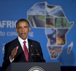 President Barack Obama gestures while speaking at a business forum aimed at increasing investment in Africa, Monday, July 1, 2013, in Dar Es Salaam, Tanzania. The president is traveling in Tanzania on the final leg of his three-country tour in Africa. (AP Photo/Evan Vucci)