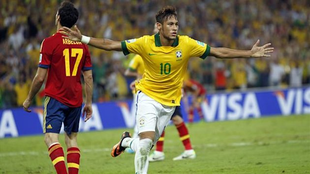 Brazil's Neymar scores against Spain (Reuters)