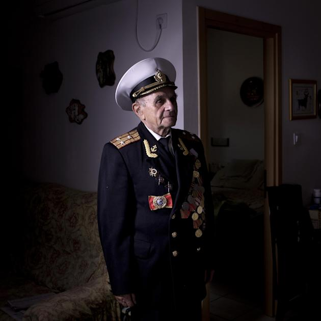 In this photo made Thursday, April 18, 2013, Soviet Jewish World War Two veteran Orlov Naum, 88, poses for a portrait at his house in central Israeli city of Rishon Lezion.  Naum joined the Red Army i