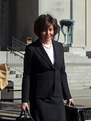 In this Wednesday, April 30, 2014 photo, Francine Katz leaves the Civil Court building in downtown St. Louis. Katz sued Anheuser-Busch in 2009, a year after resigning as vice president of communications and consumer affairs for the maker of Budweiser, Bud Light and other beers. The trail began Monday with jury selection. (AP Photo/St. Louis Post-Dispatch, Christian Gooden) EDWARDSVILLE INTELLIGENCER OUT; THE ALTON TELEGRAPH OUT