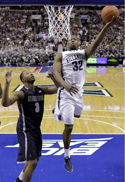 Villanova's James Bell, right, goes up for a shot against Georgetown's Mikael Hopkins during the first half of an NCAA college basketball game, Saturday, March 8, 2014, in Philadelphia