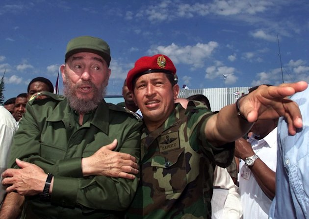 FILE - In this Oct. 28, 2000 file photo, Cuba&#39;s President Fidel Castro, left, talks with Venezuela&#39;s President Hugo Chavez in Barinas, Venezuela, near Chavez&#39;s hometown of Sabaneta. Venezuela&#39;s Vice President Nicolas Maduro announced on Tuesday, March 5, 2013 that Chavez has died. Chavez, 58, was first diagnosed with cancer in June 2011. (AP Photo/Jose Goitia, File)