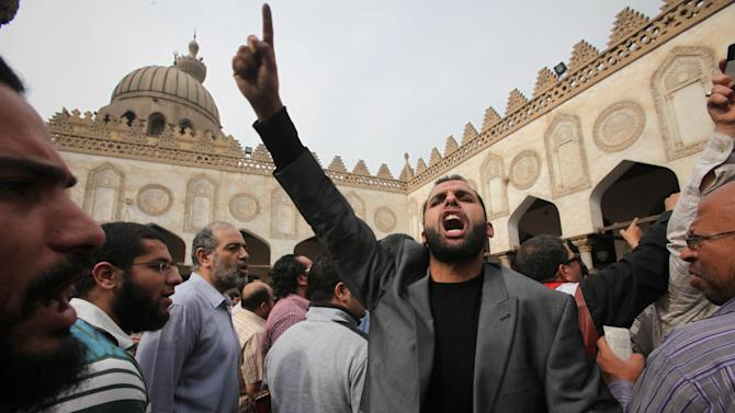 Protesters chant slogans against the Israeli invasion of Gaza, in Al-Azhar mosque, where President Mohammed Morsi's Muslim Brotherhood called for demonstrations, after Friday prayers, in Cairo, Egypt, Friday, Nov. 16, 2012. In his Friday sermon at Al-Azhar, influential cleric Sheikh Yusuf al-Qaradawi, not shown, said the Islamic world would not be silent in the face of Israel's military operation in Gaza. (AP Photo/Thomas Hartwell)