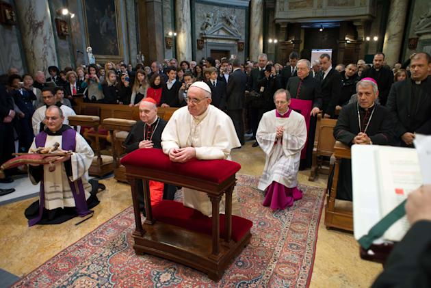 In this photo provided by the Vatican paper L'Osservatore Romano, Pope Francis kneels at the Vatican St. Anna parish church, Sunday, March 17, 2013. Pope Francis began his first Sunday as pontiff by m