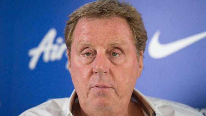 Queens Park Rangers manager Harry Redknapp responds to questions during a press conference in Sipson, west London, England, on July 28, 2014