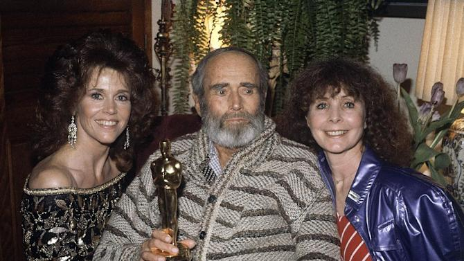 "FILE - In this March 29, 1982 file photo, from left, Jane Fonda, her father Henry Fonda, and his wife Shirlee are shown at home, after Jane accepted the Academy Award on behalf of her father for best performance by an actor in a leading role at the 54th Academy Awards, in Los Angeles. The elder Fonda, recuperating at home, was honored for his performance in ""On Golden Pond.""  (AP Photo/Reed Saxon)"
