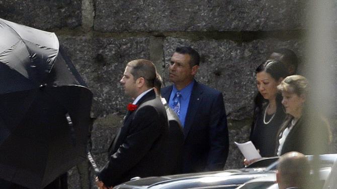 """Mourners follow the casket of actor James Gandolfini out of Cathedral Church of Saint John the Divine after funeral services, Thursday, June 27, 2013, in New York. Gandolfini, who played Tony Soprano in the HBO show """"The Sopranos"""", died while vacationing in Italy last week. (AP Photo/Julio Cortez)"""