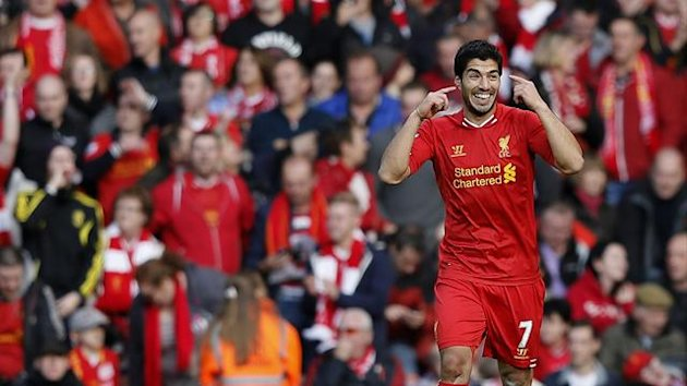 Luis Suarez celebrates scoring against West Bromwich (Reuters)