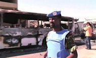 An image from a UN Supervision Mission in Syria video shows UN observers on Saturday inspecting a power transfer station in the Qabun district of Damascus after an explosion. The new head of Syria&#39;s main opposition group called Sunday for mass defections from a Syrian regime struggling to survive by carrying out massacres, as the death toll in the uprising topped 14,000