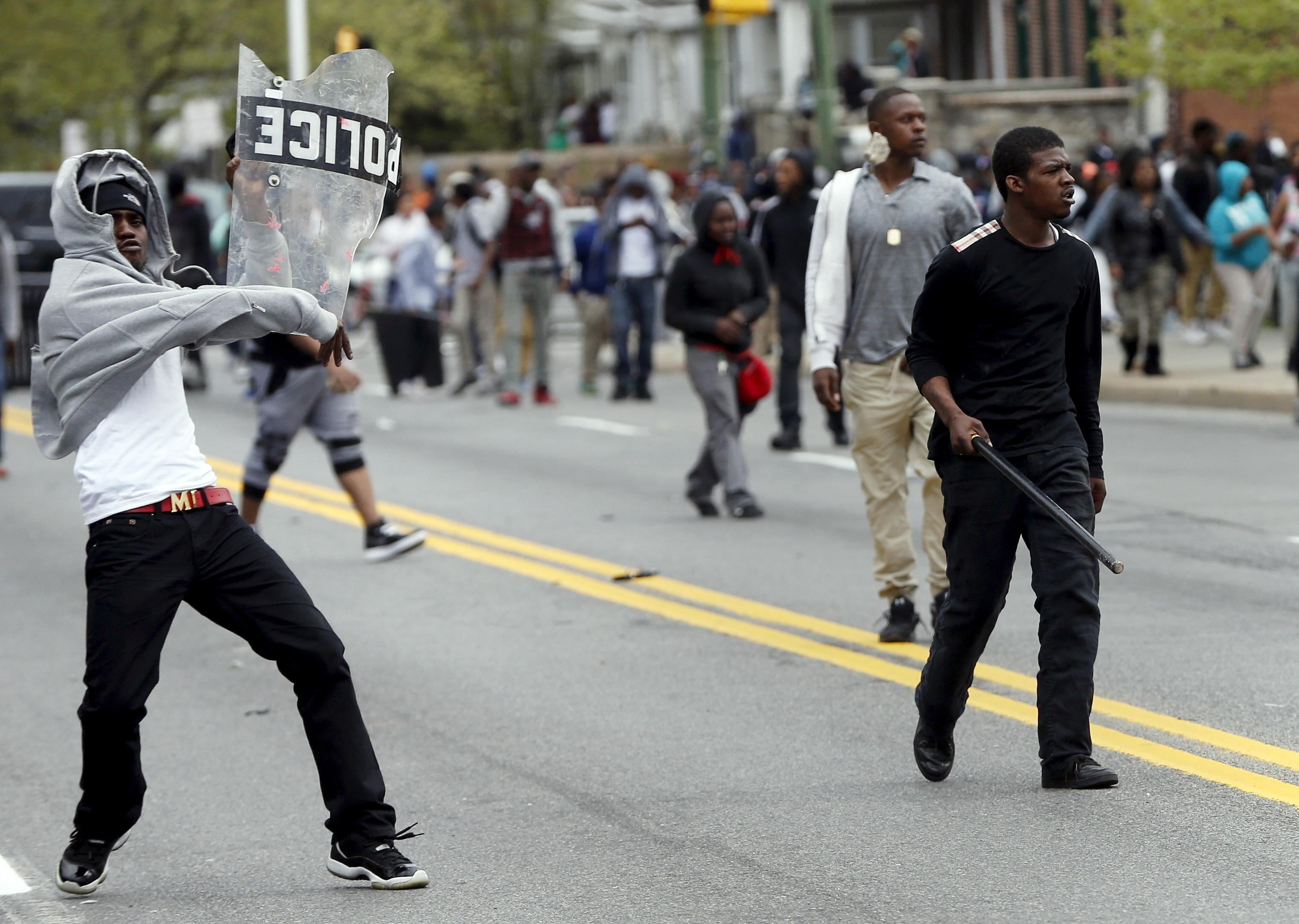 Baltimore is descending into chaos as protesters and cops clash