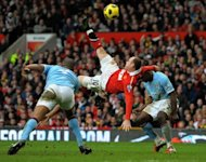 Manchester United's English striker Wayne Rooney scores during the English Premier League football match between Manchester United and Manchester City at Old Trafford in Manchester, on February 12, 2011. Rooney's stunning overhead kick in the Manchester derby in February 2011 has been voted as the greatest goal in the 20 seasons of the Premier League in a ballot of more than 300,000 fans