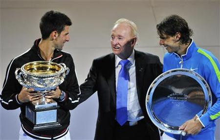 Rod Laver presents trophies to Djokovic of Serbia and Nadal of Spain after their men's singles final match at the Australian Open tennis tournament in Melbourne