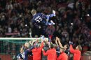 Paris Saint Germain&#039;s midfielder David Beckham from England, is thrown in the air by his teammate at the end of their French League One soccer match against Brest, at the Parc des Princes stadium, in Paris, Saturday, May 18, 2013. Paris Saint-Germain hopes to strike a deal with David Beckham in the next two weeks in which the former England captain will work with the French club after retirement, possibly in an ambassadorial role. (AP Photo/Thibault Camus)
