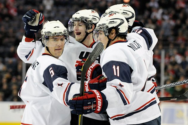 Members of Team USA celebrate the first period goal from team mate Jarred Tinordi #24 during the 2012 World Junior Hockey Championship game against Team Denmark at Rexall Place on December 26, 2011 in Edmonton, Alberta, Canada. Team USA defeated Team Denmark 11-3. (Photo by Richard Wolowicz/Getty Images)