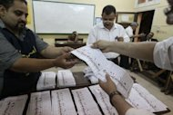 Egyptian election officials count ballots at a polling station in Cairo. Vote counting was underway in Egypt after two days of polling ended Thursday in a landmark presidential election which pitted stability against the ideals of the uprising that ended Hosni Mubarak&#39;s rule