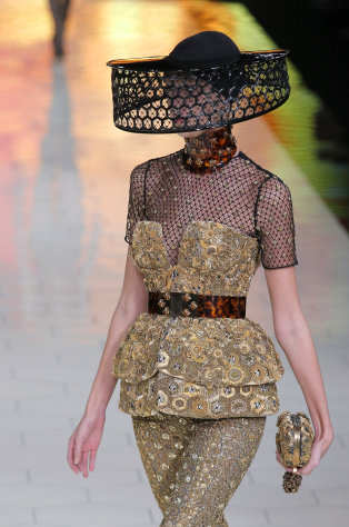 A model wears a creation by British designer Sarah Burton for Alexander McQueen as part of the ready to wear Spring-Summer 2013 collection, in Paris, Tuesday, Oct. 2, 2012. (AP Photo/Francois Mori)