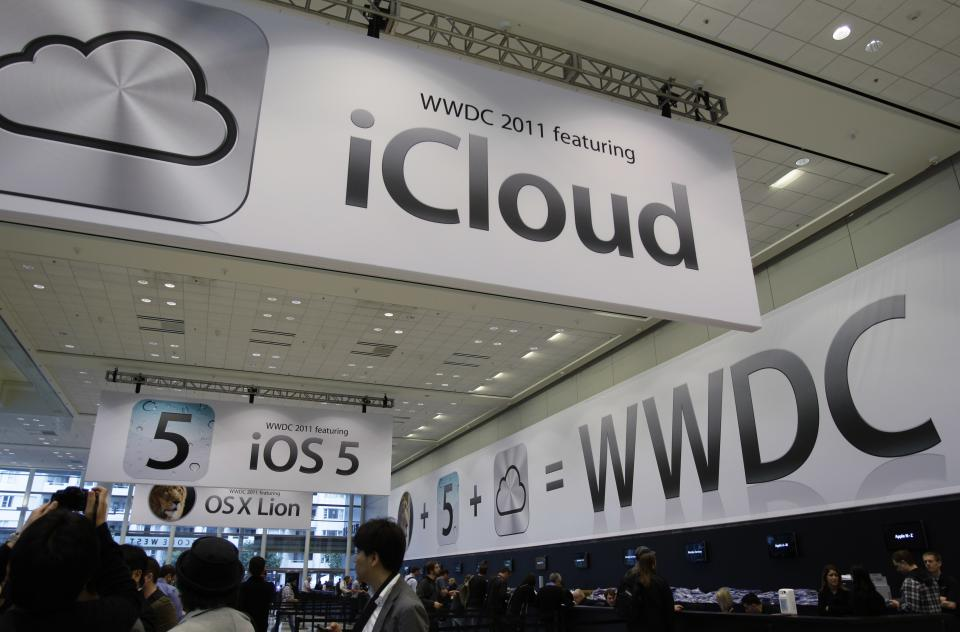 Posters on display at the Apple Worldwide Developers Conference in San Francisco, Monday, June 6, 2011. Apple CEO Steve Jobs is scheduled to take a break from medical leave Monday to announce a new service called iCloud. (AP Photo/Paul Sakuma)