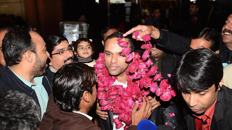 "In this picture taken on Thursday, Dec. 27, 2012, Pakistani fans receive Muhammad Shahid Nazir, center, who sings ""One Pound Fish,"" upon his arrival from London at Lahore airport in Pakistan. The 31-year-old Pakistani fishmonger catapulted to fame in recent weeks in the unlikeliest of circumstances: while hawking frozen snapper and mackerel for one British pound ($1.61) at Queens Market in London. ""One Pound Fish changed my whole life,"" said Nazir, who returned to Pakistan to a hero's welcome and has been inundated with requests to perform and do advertisements. ""I am so happy now.""(AP Photo/Hamza Ali)"