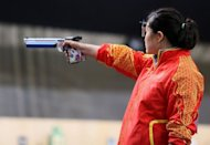 China's Guo Wenjun takes aim in the women's 10m air pistol event during the London 2012 Olympics on July 29. Guo showed nerves of steel as she came from behind on the very last shot to successfully defend her 10m air pistol Olympic title in thrilling fashion on Sunday