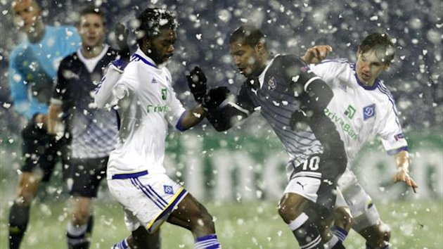 Lukman Haruna (L) of Dynamo Kyiv challenges Sammir of Dinamo Zagreb during their Champions League Group A match at Maksimir stadium in Zagre