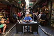"This photo, received on March 5, 2013 from Tourism Australia, shows Britain's Ben Southall sitting behind a desk in a Melbourne laneway as Australia's tourism industry resurrected its hugely popular ""Best Jobs in the World"" campaign, offering a chance to become a chief funster, taste master, or outback adventurer"