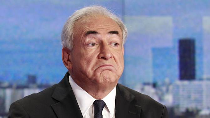 """Dominique Strauss-Kahn, former head of the International Monetary Fund, looks on prior to a television interview at the TV news broadcast by French TV station TF1, in Boulogne-Billancourt, outside Paris, Sunday Sept. 18, 2011. Strauss-Kahn has dismissed French writer Tristane Banon's claims that he tried to rape her during a 2003 interview as """"imaginary"""" and insisted there was """"no act of aggression, no violence."""" (AP Photo/Francois Guillot, pool)"""