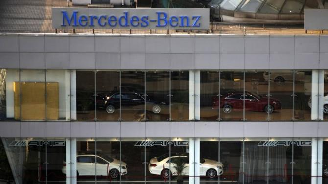 A Mercedez-Benz sign is seen at a dealership in downtown Shanghai