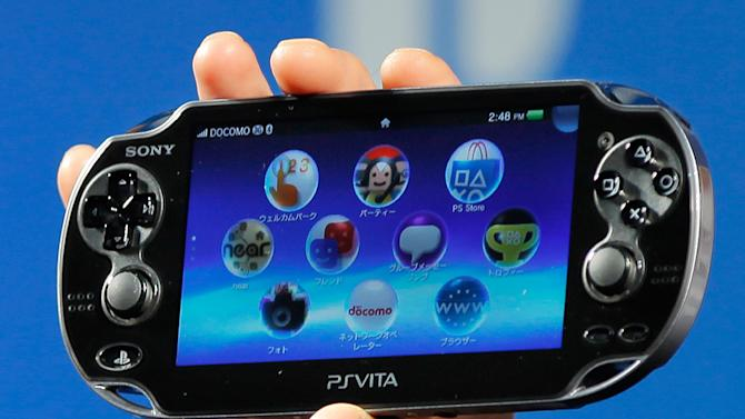 FILE - In this Sept. 14, 2011 file photo, Sony Computer Entertainment's PlayStation Vita is shown during a press conference in Tokyo. Sony Corp. is pulling the plug on its PlayStation Portable hand-held video game machine after 10 years. The Japanese electronics and entertainment company has been pushing the successor machine PlayStation Vita. (AP Photo/Itsuo Inouye, File)