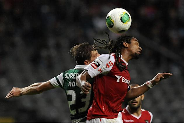 Sporting's Adrien Silva, left, challenges for a high ball Sporting Braga's Alan Silva, from Brazil, during their Portuguese League soccer match at the Municipal Stadium, in Braga, Portugal, Saturday S