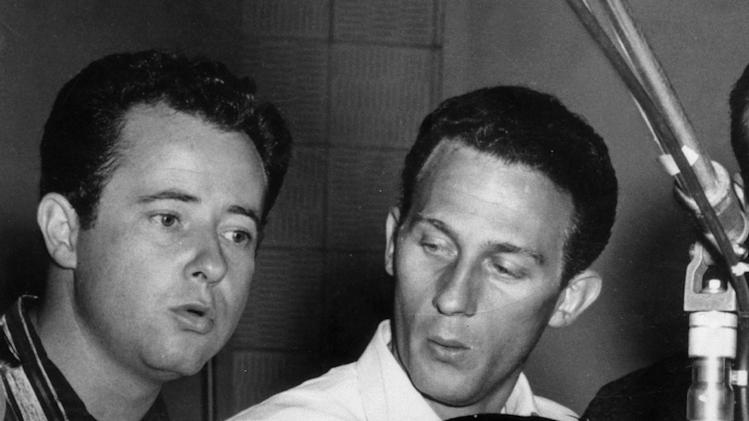 This undated image released by the Country Music Hall of Fame shows Elvis performing with the Jordanaires' Jordan Stoker, left, and Hoyt Hawkins.  Stoker, a member of The Jordanaires vocal group that backed Elvis Presley, died Wednesday, March 27, 2013 at his home in Brentwood, Tenn., after a lengthy illness. He was 88. (AP Photo/Country Music Hall of Fame)