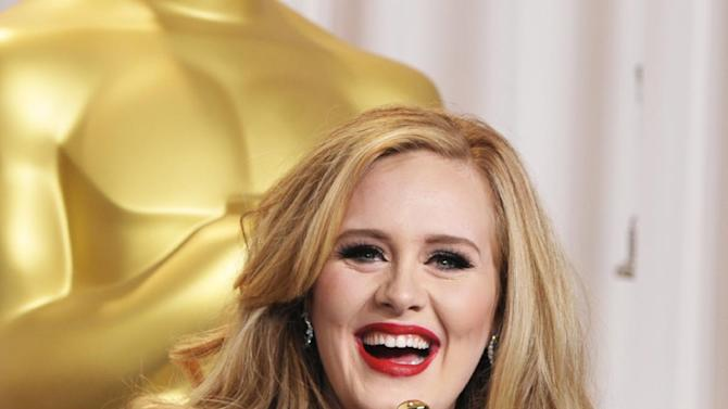 """Adele poses with her award for best original song for """"Skyfall"""" during the Oscars at the Dolby Theatre on Sunday Feb. 24, 2013, in Los Angeles. (Photo by John Shearer/Invision/AP)"""