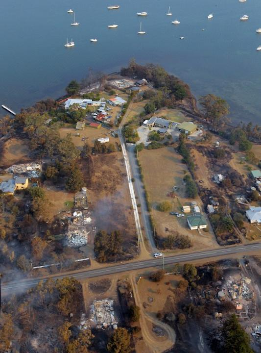 This aerial photograph taken on January 5, 2013 shows the devastated town of Dunalley after bush fires swept through the area.  Thousands of people have fled wildfires raging on the Australian island
