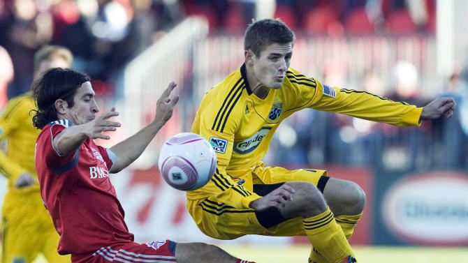"FILE - In this Oct. 16, 2010, file photo, Toronto FC defender Nick Garcia, left, battles for the ball against Columbus Crew midfielder Robbie Rogers, right, during first half MLS soccer action in Toronto. Former MLS and U.S. national team player Robbie Rogers says he is gay. In a post on his personal website, Rogers writes: ""Life is only complete when your loved ones know you. ... Try explaining to your loved ones after 25 years you are gay."" (AP Photo/The Canadian Press, Nathan Denette, File)"