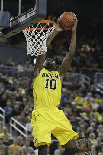 No. 20 Michigan pulls away to beat Bradley 77-66