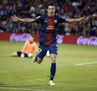 Barcelona's forward Cristian Tello celebrates after scoring during their Spanish league football match against Real Valladolid at the Jose Zorilla stadium in Valladolid on December 22, 2012. Barcelona won 3-1