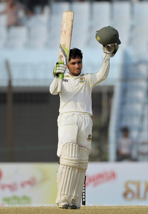 Bangladesh's Mominul Haque acknowledges the crowd after scoring a century on the fifth day of the second test cricket match against Bangladesh in Chittagong, Bangladesh, Saturday, Feb. 8, 2014. Sri La