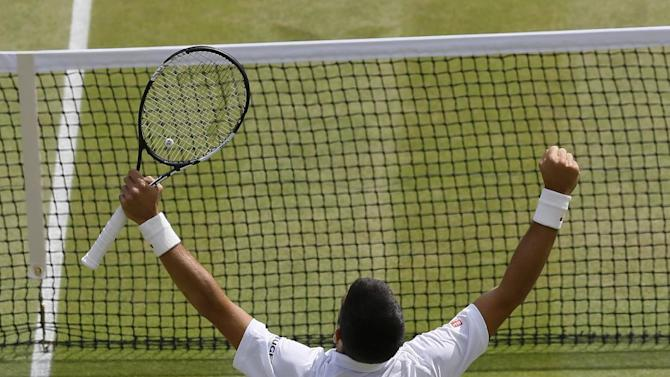 Novak Djokovic of Serbia celebrates winning the singles match against Kevin Anderson of South Africa, at the All England Lawn Tennis Championships in Wimbledon, London, Tuesday July 7, 2015.  Djokovic won 6-7, 6-7, 6-1, 6-4, 7-5 (AP Photo/Kirsty Wigglesworth)
