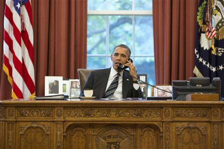U.S. President Barack Obama talks with Iranian President Hassan Rouhani during a phone call in the Oval Office at the White House in Washington September 27, 2013. REUTERS/Pete Souza/The White House/Handout via Reuters