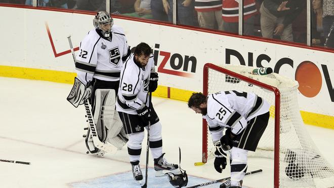 Jonathan Quick #32, Jarret Stoll #28 And Dustin Penner #25 Of The Los Angeles Kings Recover From A Scuffle In Front Of Getty Images