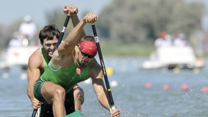 Lithuania's Raimundas Labuckas, front, and Tomas Gadeikis, back, paddle before winning the 200 meters C2 men's final race at the Canoe Sprint World Championships in Szeged, Hungary, Sunday, Aug. 21, 2011. (AP Photo/Bela Szandelszky)