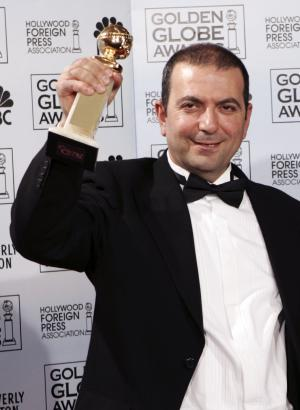 "FILE - This is a Monday, Jan. 16, 2006 file photo of  Hany Abu-Assad, writer/director of ""Paradise Now,"" accepts the Golden Globe Award for Best Foreign Language film at the 63rd Annual Golden Globe Awards  in Beverly Hills, Calif. (AP Photo/Reed Saxon, File)"