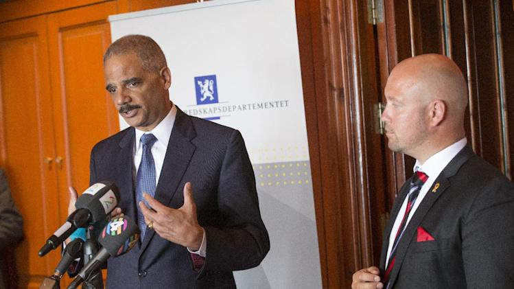 Norway's Minister of Justice Anders Anundsen, right, looks on as US Attorney General Eric Holder, speaks to the media in Oslo Tuesday July 8, 2014 . Holder is in Norway to make a major address on international efforts to confront the security threat posed by violent extremists traveling to and from Syria. (AP Photo/Terje Bendiksby/ NTB Scanpix)