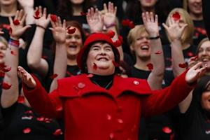 Singer Susan Boyle smiles as poppy's fall over her at a photocall during the launch of the Poppy Scotland appeal in Glasgow, Scotland