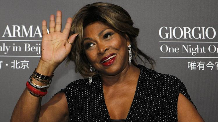 FILE - A Thursday, May 31, 2012 photo from files showing U.S. singer actress Tina Turner arriving for the Giorgio Armani fashion show held in Beijing. Legendary rock singer Tina Turner has married her longtime German beau, Erwin Bach, in a Swiss civil ceremony. The mayor of Kuesnacht, the wealthy Zurich-area community where Turner lives, says that she and Bach, a music executive, were married several weeks ago at the registry office. Markus Ernst told The Associated Press on Thursday, July 18, 2013, it was a routine ceremony, ahead of a private celebration on Sunday at the couple's home. (AP Photo/Ng Han Guan, File)