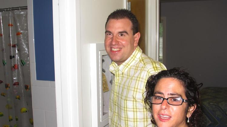 In this photo taken Monday, July 1, 2013, newlyweds Paul and Hava Forziano give a tour of their new apartment at a group home in Riverhead, N.Y. The mentally disabled couple started a court fight after the group homes where they formerly lived denied them the opportunity to live together as a married couple. (AP Photo/Frank Eltman)