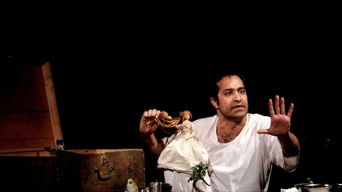 "This undated image released by The Public Theater shows Iranian actor Afshin Hashemi in a scene from ""Hamlet, Prince of Grief,"" running January 10-20 at The Public Theater at Astor Place as part of the Under the Radar Festival 2013. (AP Photo/The Public Theater, Medhi Shaban)"