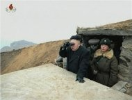 North Korean leader Kim Jong-un looks through a pair of binoculars at an undisclosed location, in this still image taken from video shown by North Korea&#39;s state-run television KRT on March 8, 2013. REUTERS/KRT via Reuters TV