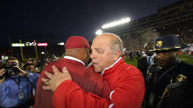 Stanford head coach David Shaw, left, is congratulated by Wisconsin head coach Barry Alvarez, right, following Stanford's 20-14 win in the Rose Bowl NCAA college football game, Tuesday, Jan. 1, 2013, in Pasadena, Calif. (AP Photo/Mark J. Terrill)